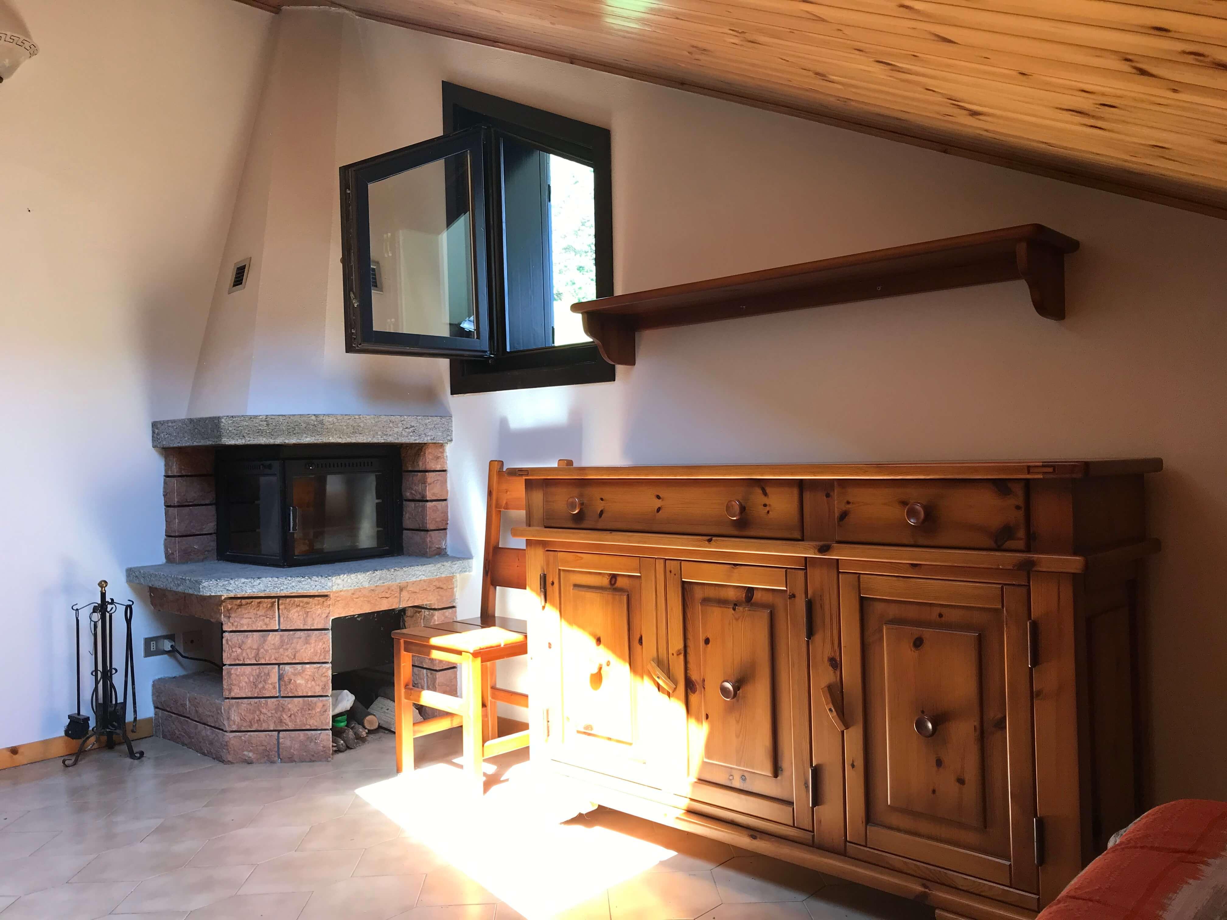 Immobiliare Abita mansarda bilocale in vendita - soggiorno, camino